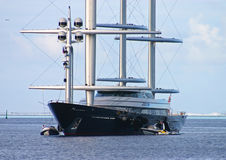 Maltese Falcon 2. Photo of the grand Maltese Falcon entering a placid bay in Huahine Stock Photo