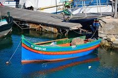 Maltese fishing boat, Mgarr, Gozo. Colourful traditional Maltese Dghajsa fishing boat moored in the harbour, Mgarr, Gozo, Malta, Europe Royalty Free Stock Image
