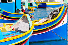Maltese fishing boats. Traditional Maltese fishing boats, called Luzzu, in the harbour of Marsaxlokk, Malta Stock Photos