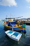 Maltese fishing boats. Traditional Maltese fishing boats, called Luzzu, in the harbour of Marsaxlokk, Malta royalty free stock photography