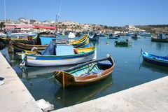 Maltese fishing boats. Typical Maltese Fishing Boats (Luzzo) in the touristy fishing village of Marsa Shlok, Malta Royalty Free Stock Images