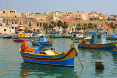 Maltese fishing boats at moorings. Colourful Maltese fishing boats in Marsaxlokk harbour, Malta Stock Image