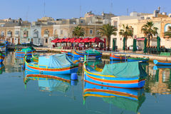 Maltese fishing boats in port. Colourful Maltese fishing boats in Marsaxlokk harbour, Malta Royalty Free Stock Photography