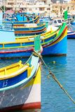 Maltese fishing boats in Marsaxlokk harbour. Traditional Maltese Dghajsa fishing boats in the harbour, Marsaxlokk, Malta, Europe Stock Photography