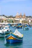 Maltese fishing boats in Marsaxlokk harbour. Royalty Free Stock Photo