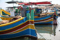 Maltese Fishing boats. Old Maltese traditional Luzzu boats tied up at the quay Royalty Free Stock Photography