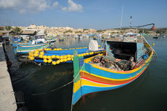 The maltese fishing village. Colorful boats Stock Image