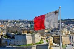 Maltese flag. And Senglea (Isla) cityscape Stock Image