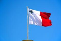 Maltese flag against a blue sky. Royalty Free Stock Photography