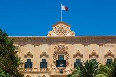 Valletta, Malta. Maltese Flag on Auberge de Castille in Valletta, Malta - office of the Prime Minister of Malta Royalty Free Stock Images