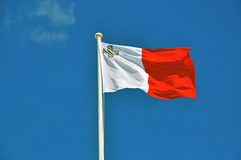 Maltese flag on blue sky Stock Photography