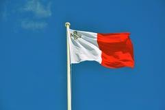 Maltese flag on blue sky. Background Stock Photography