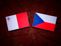 Maltese flag with Czech flag on a tree stump. Maltese flag with Czech flag on a tree stump Royalty Free Stock Photography