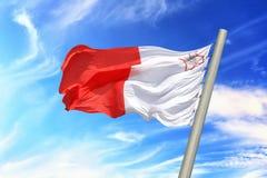Maltese flag. Flag of Malta against the background of the sky Stock Photo