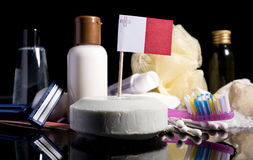 Maltese flag in the soap with all the products for the people hy. Giene Stock Photography