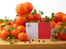 Maltese flag on a wooden panel with tomatoes isolated on a white Stock Photo