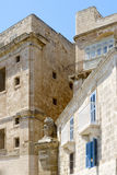 Maltese houses with a lion statue Royalty Free Stock Photography