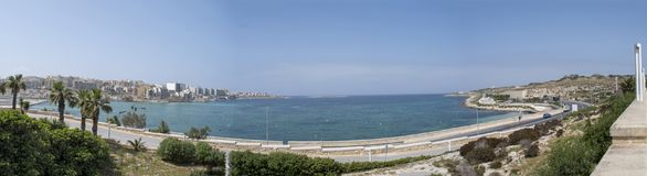 Maltese islands Qawra bay panoramic view. Malta - panoramic view of Qawra bay and Qawra town located north of the island Royalty Free Stock Photo