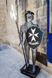 Maltese knight at the shop entrance. In the town of Mdina, Malta Royalty Free Stock Photo