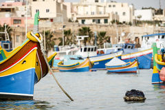 Maltese Luzzu fishing boat, Marsaxlokk, Malta. A view across Marsaxlokk harbor dominated by traditional Maltese fishing boats, Luzzu, decorated in their familiar Stock Images