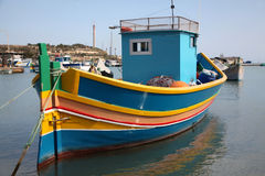 Maltese Luzzu Fishing Boat. A traditional Luzzu fishing boat moored in the harbour of Marsaxlokk in Malta Stock Photography