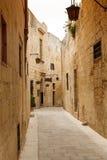 Maltese narrow street Mdina, Malta. Traditional narrow street in Malta. Maltese architecture in Mdina, Malta Royalty Free Stock Photography