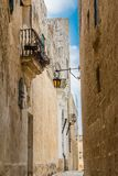 Maltese narrow street in Mdina. With stone buildings in traditional architecture Stock Photography