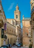 Maltese narrow street in Mdina. With stone buildings in traditional architecture Stock Image