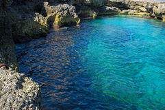 Maltese natural swimming pool. All around the Maltese coast are these beautiful natural sea water pools ... so exhilarating when entering Stock Images