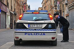 Maltese police. VALLETTA, MALTA - FEBRUARY 28: Car of Malta police department and constable on the street of Valletta on february 28, 2014. Valletta is a capital Stock Images