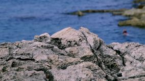 Maltese rock landscape with diver on background stock video footage