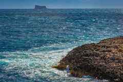 Maltese rocky coast and Filfla island Royalty Free Stock Images