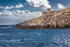 Maltese rocky coast. Mediterranean sea Royalty Free Stock Photo