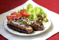 Maltese sausage served with fresh vegetables. Olives Royalty Free Stock Images