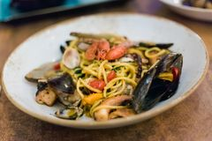 Maltese seafood mix spaghetti. Traditional maltese seafood mix spaghetti with calamari, giant shrimps, clams and mussels served in local restaurant. Delicious Royalty Free Stock Images