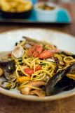 Maltese seafood mix spaghetti. Traditional maltese seafood mix spaghetti with calamari, giant shrimps, clams and mussels served in local restaurant. Delicious Stock Photography