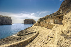 Maltese seascape, with a hidden boat houses. The photo taken in Gozo-island, which is part of Malta Stock Photos