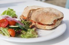 Maltese snack ftira isolated in white background served with fresh vegetable. Maltese ftira Stock Image