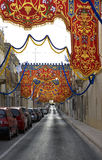 Maltese street decorated on religious feast time. Paola, Malta. Maltese street decorated on religious feast time Stock Image