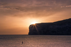Maltese sunset. Over the cliff in very warm color Royalty Free Stock Photography