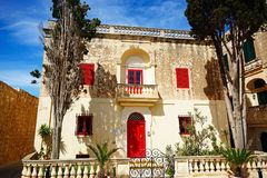Maltese townhouse, Mdina. Townhouse with a red door and window frames in Bastion Square, Mdina, Malta, Europe Royalty Free Stock Photography