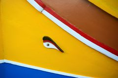 Maltese traditional boat Luzzu detail. Abstract close up view of the Maltese wooden fishing boat called Luzzu with traditional decoration and vibrant painting royalty free stock photography