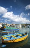 Maltese traditional painted luzzu boats in marsaxlokk fishing vi. Maltese traditional colorful painted luzzu boats in marsaxlokk fishing village malta Royalty Free Stock Photography