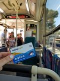 Maltese transport card Tallinja in girl`s hand in a bus with passengers royalty free stock photos