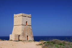 Maltese watch tower. A Maltese watch tower, built during the reign of the Knights of the Order of St John, is watching over the Mediterranean Sea in Golden Sands Stock Photography