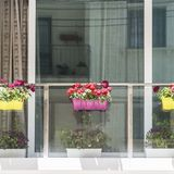 Maltese window decorated with flowers. Building with modern window decorated with fresh flowers on Malta Stock Photography