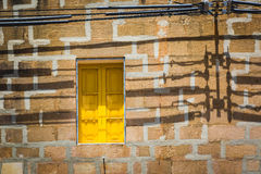 Maltese yellow window in power shadows Royalty Free Stock Photos