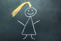 Malująca dziewczyna z żółtym warkoczem na blackboard royalty ilustracja