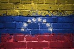 Malująca flaga państowowa Venezuela na ściana z cegieł Fotografia Royalty Free