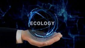Malująca ręka pokazuje pojęcie holograma ekologię na jego ręce Zdjęcia Royalty Free